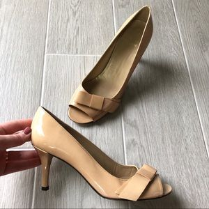 Stuart Weitzman nude patent pumps with bow detail